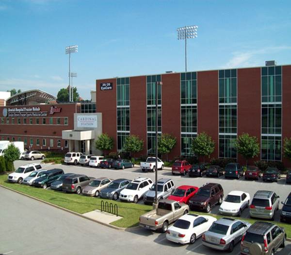 Campus Health building with cars in the parking lot